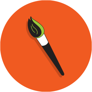paintbrush with green paint on an orange circle